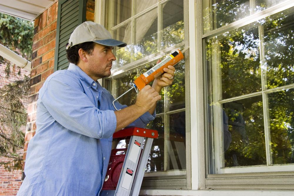 Image result for man fixing window